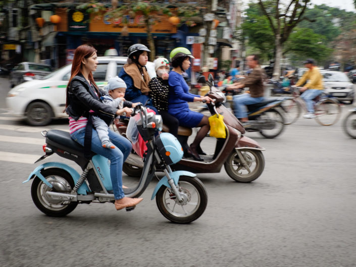 Vietnamese woman and baby on moped