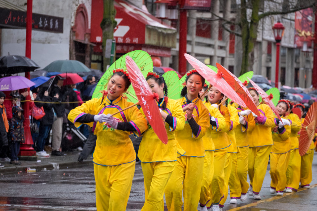 Young lady dancers holding Chinese-styled umbrellas